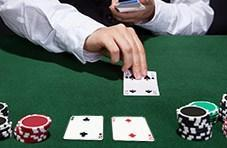 a poker table with two 2's next to each other and the dealer's hand with a 4