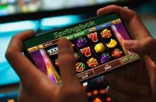 A player playing Springbok Casino on his mobile phone