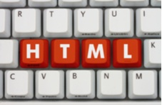 computer keyboard with HTML on red keys