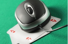 computer mouse sitting on top of a pair of aces