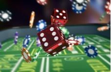 craps dice flying across a craps table with casino chips in the background