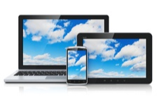 laptop screen, tablet and phone screens with sky and clouds on the screens