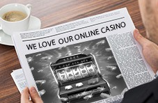 "Newspaper with the headline ""We Love Our Online Casino"""