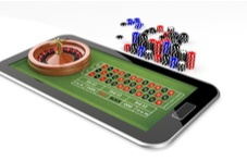 roulette table on a smartphone with casino chips around