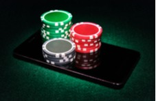 stacks of real casino chips sitting on a smartphone