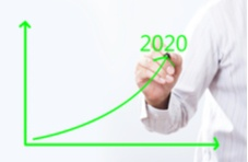 business man drawing an upward graph with 2020 written on it