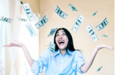 happy woman with dollar bills falling down on her